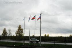флагштоки с флагами
